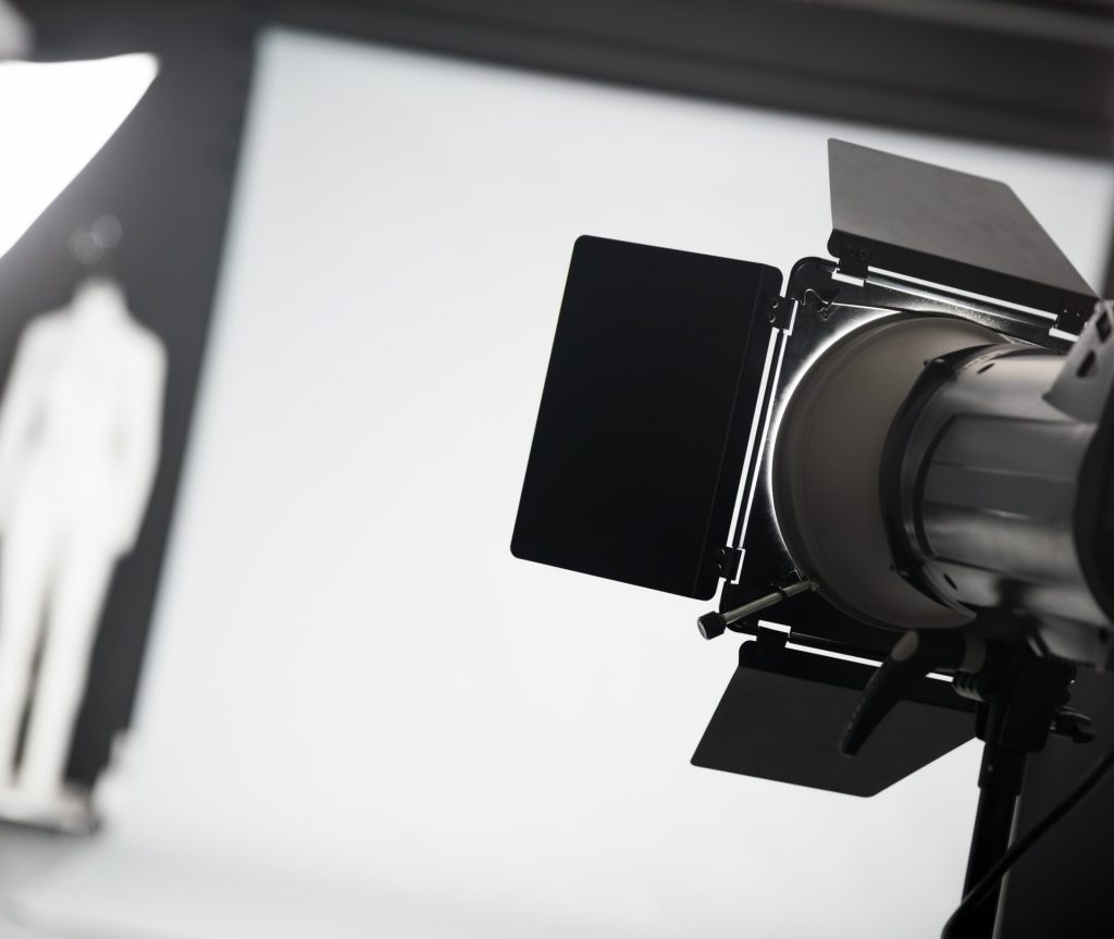 Photo studio with lighting equipment. Focus on a lamp. Professional photography.